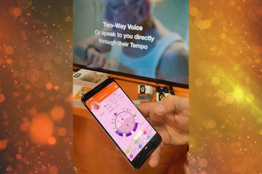 A person holds up the app connected to the smart watch CarePredict, which monitors seniors' daily activity  (Image: Julie JAMMOT / AFP)