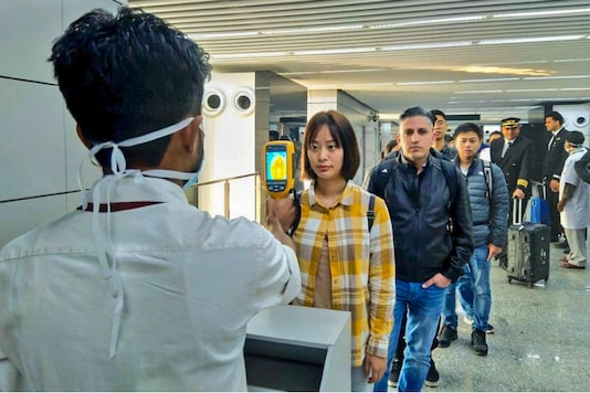 A thermal screeening device checks passengers arriving from China at the Kolkata airport on Tuesday. (PTI)
