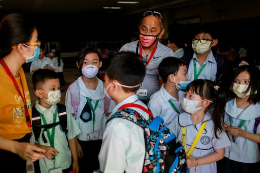 Guardians and students wear masks. (Reuters)