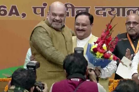 Home Minister Amit Shah congratulates JP Nadda after he takes over as BJP president.