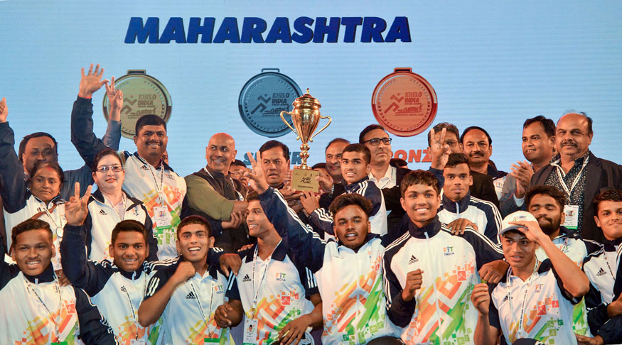 Assam Chief Minister Sarbananda Sonowal with State Finance Minister Himanta Biswa Sarma hands over champion's trophy to Maharashtra during the closing ceremony of the Third Edition of Khelo India Youth Games 2020, in Guwahati. (Image: PTI)
