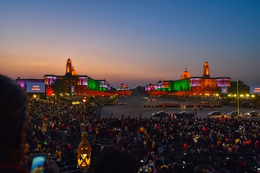 For representation: People take photographs of the Rashtrapati Bhavan, illuminated in tricolours of the Indian Flag, during the Beating Retreat ceremony at Vijay Chowk, in New Delhi. (Image: PTI)