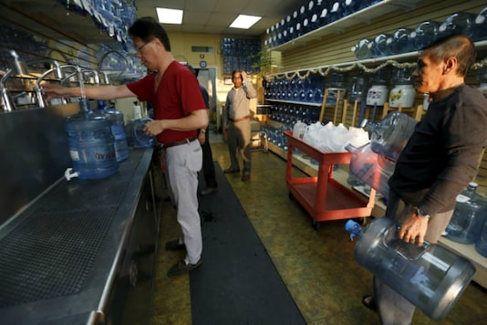 FILE PHOTO: People refill bottles at a water store in Temple City, California, United States March 4, 2016. REUTERS/Mario Anzuoni