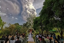 Couple Ties Knot Amid Swirling Clouds as Volcano Erupts in the Background