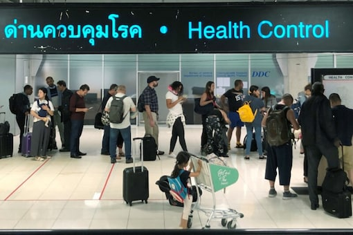 File photo of tourist lining up in a health control at the arrival section at Suvarnabhumi international airport in Bangkok, Thailand, January. (Reuters)