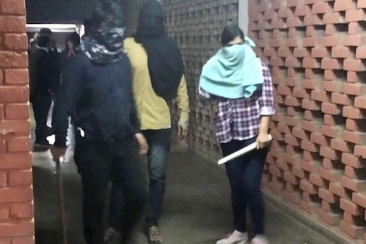 Komal Sharma can be seen wearing a check shirt, light blue scarf and carrying a stick in the purported video of the JNU attack.