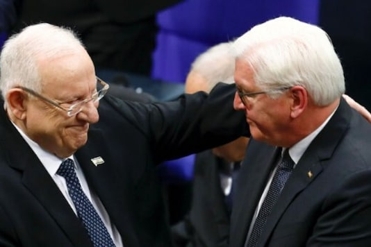 Israeli President Reuven Rivlin and German President Frank-Walter Steinmeier embrace during the commemoration service of victims of the Nazi dictatorship at Germany's lower house of parliament, Bundestag, in Berlin, Germany