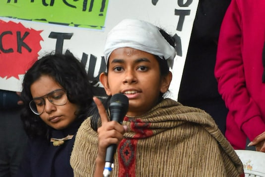 JNU students union president Aishe Ghosh speaks to the media during a press conference in New Delhi, on January 6, a day after she was injured in an assault by a masked mob on campus. (PTI)
