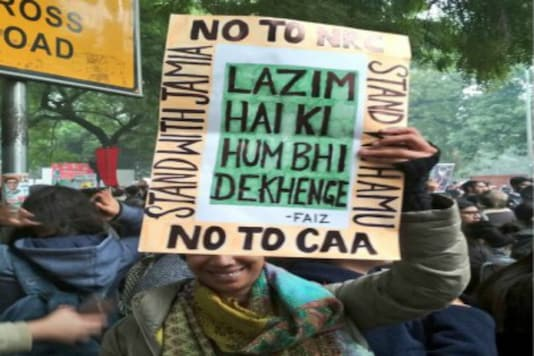 A protester holds up a placard with Faiz's iconic words during a demonstration against the Citizenship Amendment Act (CAA) at Jamia Nagar in New Delhi.