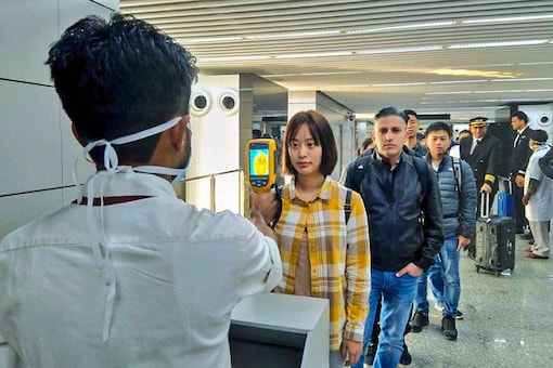 A thermal screeening device checks passengers arriving in India fromChina including Hong Kongin view of outbreak of Novel coronavirus (CoV) in China, at the Kolkata airport. (Image: PTI)