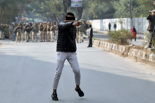 File photo of the shooter brandishing his gun during a protest against CAA outside the Jamia Millia Islamia in New Delhi on Jan 30, 2020. (REUTERS)