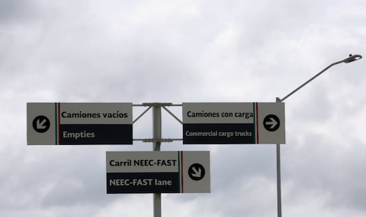 Direction signs for trucks are seen at a border customs control to cross into U.S. at the World Trade Bridge in Nuevo Laredo, Mexico June 5, 2019. REUTERS/Carlos Jasso/File Photo