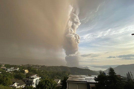 Plumes of smoke and ash rise from as Taal Volcano erupts in Tagaytay, Philippines. (Image: AP)