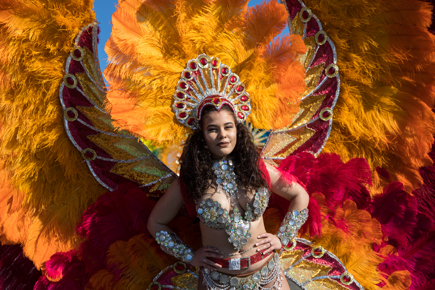 A costumed participant performs during the flower parade of the 136th edition of the Nice carnival. (Image: AP)