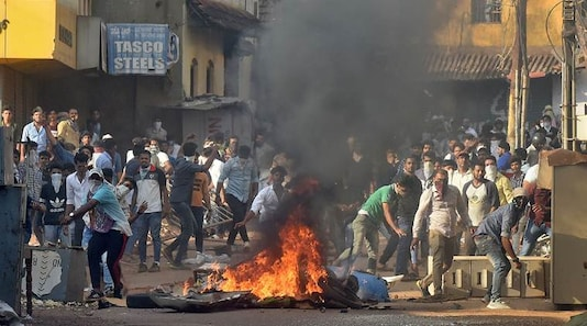Demonstrators throw stones towards police during a protest against a new citizenship law, in Mangaluru, India, December 19, 2019. (Reuters)