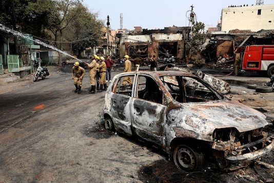 File photo of a car burnt during the riots in Delhi.