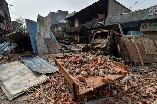 Brick-bats are seen amid vandalised properties in Bhagirathi Vihar area of the riot-affected north east Delhi. (Image: PTI)