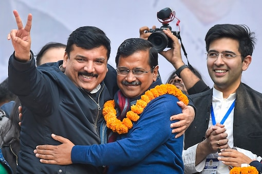 AAP convenor Arvind Kejriwal hugs party leader Sanjay Singh during his address to supporters in New Delhi on Tuesday. (PTI)