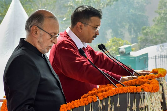 Arvind Kejriwal being sworn in as the Chief Minister of Delhi by Lt Governor Anil Baijal in New Delhi on Sunday. (PTI)