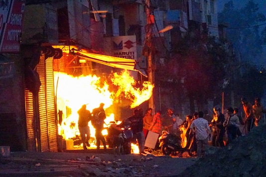 Rioters set ablaze a shop during clashes between those against and those supporting the Citizenship (Amendment) Act in at Gokalpuri in north east Delhi on February 25, 2020. (Image: PTI)