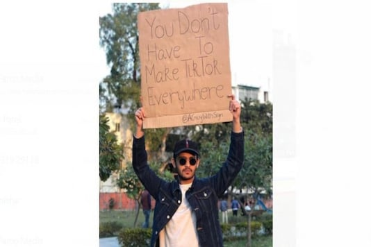 A GUY WITH SIGN Making Best Utilization Of Social Resources To Convey His Message To The World