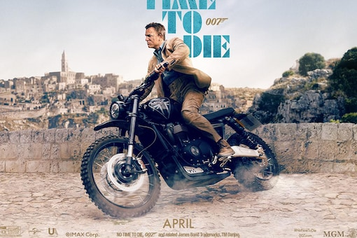 """James Bond actor Daniel Craig on the Triumph Scrambler 1200 XC XE in a poster of the upcoming movie No Time to Die. (Photo Courtesy: Instagram/<a href=""""https://www.instagram.com/p/B8y2xjMpGGV/?utm_source=ig_web_copy_link"""" target=""""_blank"""">007</a>)"""