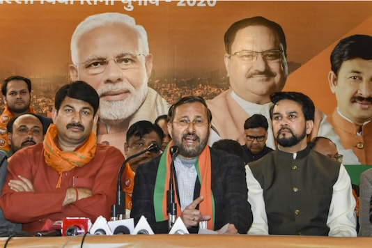 Union Minister Prakash Javadekar flanked by Delhi BJP President Manoj Tiwari and MoS Anurag Thakur in New Delhi on Monday. (PTI)