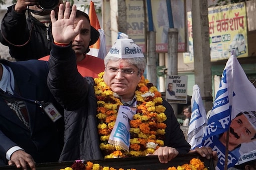 Delhi Transport & Revenue Minister Kailash Gahlot during a election campaign rally before filing his nomination for the upcoming State Assembly elections, at Najafgarh in New Delhi. (Image: PTI)