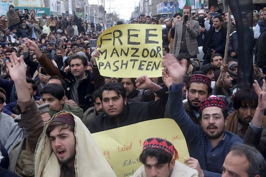 Supporters of Pashtun Tahafuz Movement (PTM) hold signs as they chant slogans during a country-wide protests over the arrest of their leader and student activist Manzoor Pashteen, in Quetta, Pakistan (Reuters).
