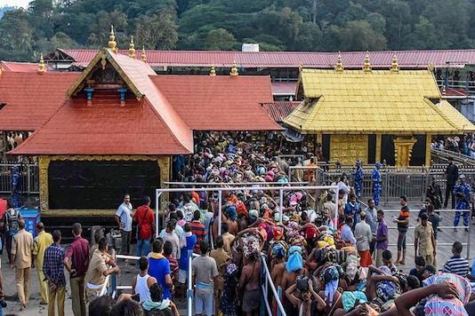 For representation: Devotees arrive at the Lord Ayyappa temple that opened for the two-month long Mandala-Makaravillakku pilgrimage season, in Sabarimala. (Image: PTI)