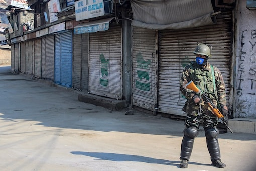 Image for representation: A security personnel stands guard at a closed market, in Srinagar. (PTI/File Photo)