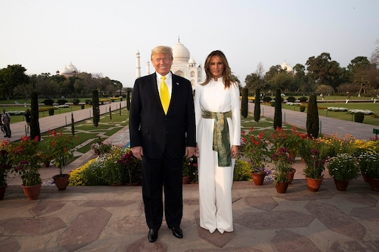 President Donald Trump, with first lady Melania Trump, pause as they tour the Taj Mahal, Monday, February 24, 2020, in Agra, India. (Image: AP/PTI)