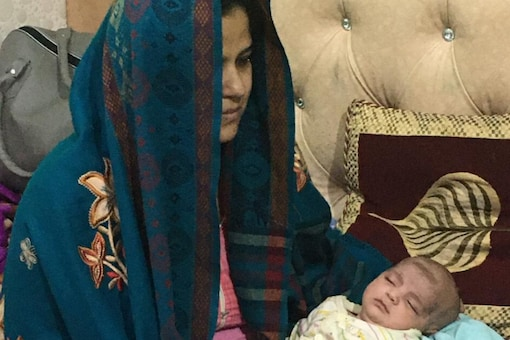 Mudassir Khan's wife Imrana with their youngest daughter who was born 15 days ago. (News18)