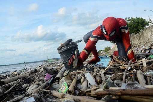 Rudi Hartono struggled to persuade his community members to clean trash, until he dressed up as Spider-Man. (Reuters)