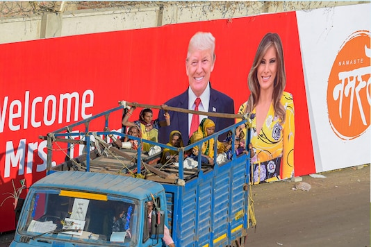 Workers move out of Sardar Patel Stadium, commonly known as Motera Stadium, which will host 'Namaste Trump' event during US President Donald Trump's maiden visit to Ahmedabad on Saturday. (PTI)