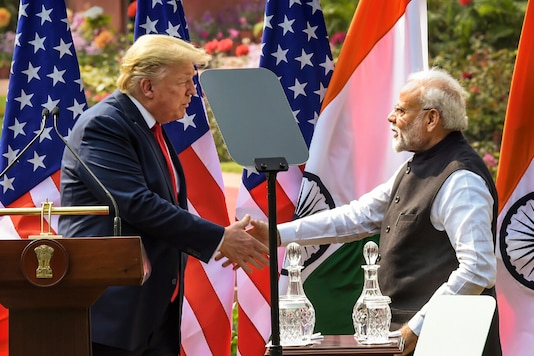 Prime Minister Narendra Modi (R) and US President Donald Trump exchange greetings after their joint press statement, at the Hyderabad House in New Delhi on Tuesday. (PTI)
