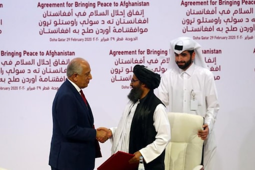 File photo of Mullah Abdul Ghani Baradar, the leader of the Taliban delegation, and Zalmay Khalilzad, US envoy for peace in Afghanistan, shake hands after signing an agreement at a ceremony between members of Afghanistan's Taliban and the US in Doha, Qatar. (Reuters)