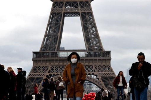 A woman wears a protective mask in light of the coronavirus outbreak in China as she walks at the Trocadero esplanade in front of the Eiffel Tower in Paris, France. (Reuters)