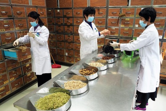 Medical workers prepare traditional Chinese medicine (TCM) at a TCM hospital as the country is hit by an outbreak of the new coronavirus, (Reuters)