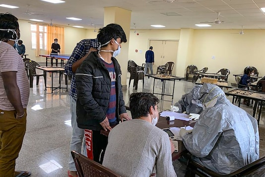 New Delhi: In this handout photo provided by Indo-Tibetan Border Police (ITBP), Indian nationals who were airlifted from coronavirus-hit Hubei province of China's Wuhan, undergo screening at a quarantine facility set by up ITBP, at Chhawla area in New Delhi, Saturday, Feb. 15, 2020. (PTI Photo)