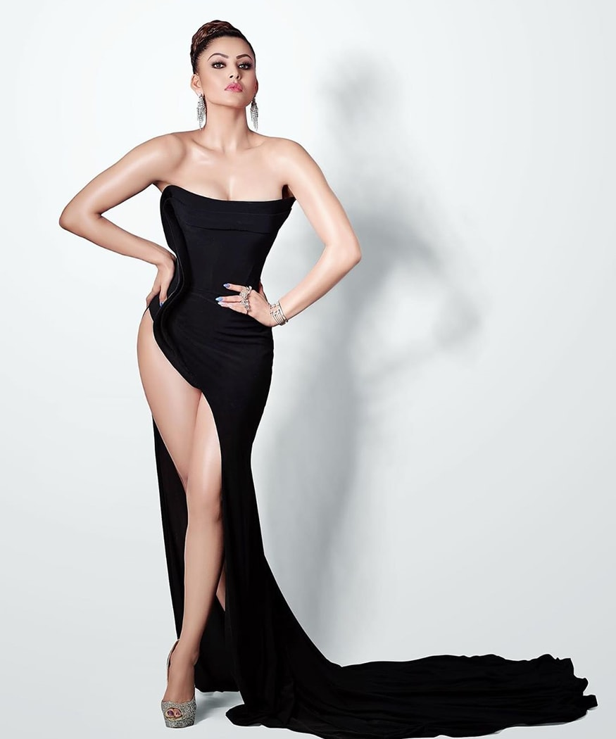 Bollywood actress Urvashi Rautela wowed all with her Filmfare awards 2020 curtain-raiser look. She was seen comfortably flaunting her toned body in a black risque dress. (Image: Instagram)