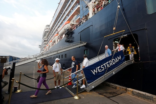 Passengers leave of MS Westerdam, a cruise ship that spent two weeks at sea after being turned away by five countries over fears that someone aboard might have the coronavirus, as it docks in Sihanoukville, Cambodia. (Reuters)