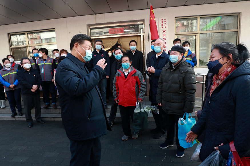 Chinese President Xi Jinping wearing a protective face mask speaks to residents as he inspects the novel coronavirus pneumonia prevention and control work at neighbourhoods in Beijing. (Image: AP)