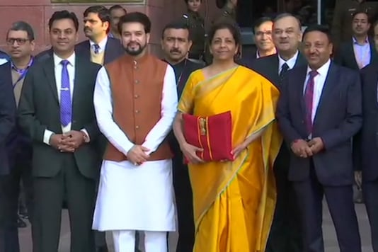 Finance minister Nirmala Sitharaman with union minister Anurag Thakur and finance ministry officials.