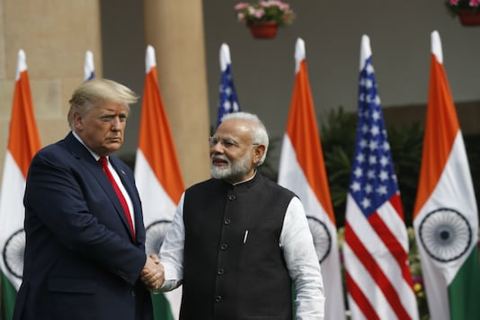 US President Donald Trump and Prime Minister Narendra Modi shake hands before their meeting at Hyderabad House in New Delhi on February   25, 2020. (AP Photo)