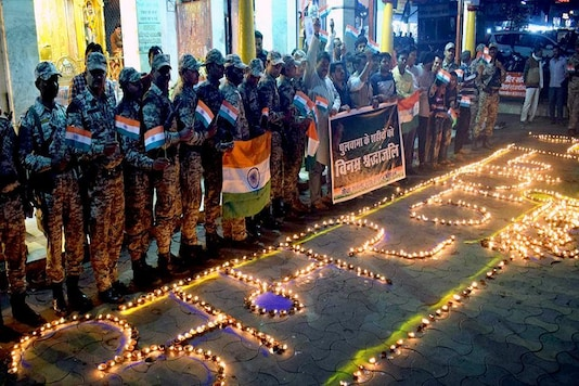 Members of Sewa Sankalp Yuva Sangathan light lamps to pay tributes to the martyrs of Pulwama terror attack on the first anniversary of the incident in Bhopal on Thursday. (ANI Photo)