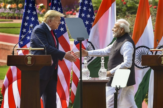 Prime Minister Narendra Modi (R) and US President Donald Trump exchange greetings after their joint press statement, at the Hyderabad House in New Delhi on February 25, 2020. (PTI Photo/Shahbaz Khan)