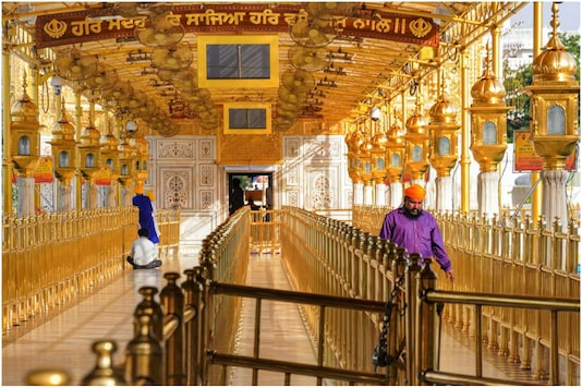 Amritsar: Few devotees are seen inside Golden Temple on the occasion of Vaisakhi festival during a government-imposed nationwide lockdown as a preventive measure against the coronavirus pandemic, in Amritsar. (Image: PTI)
