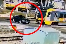 WATCH: Freak BMW Accident With High-Speed Train Goes Viral as Driver Walks Away Alive