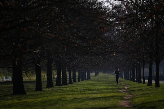 A woman jogs in Hyde Park as the spread of the coronavirus disease (COVID-19) continues, in London, Britain. (Reuters)